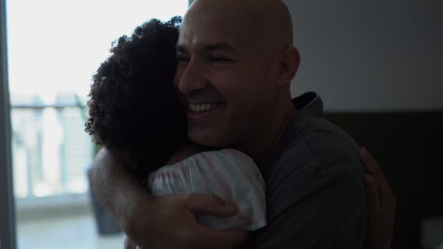 daughter talking to deaf father and embracing him at home - 35 39 years stock videos & royalty-free footage