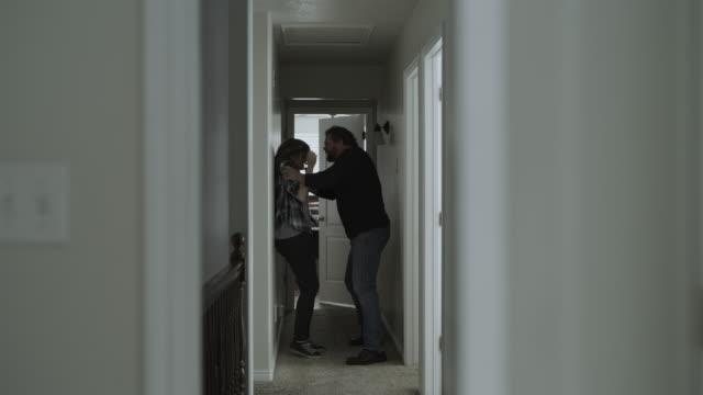 vídeos de stock e filmes b-roll de daughter watching domestic violence from doorway then crying / springville, utah, united states - springville utah