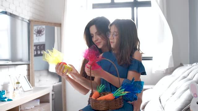 daughter with easter eggs basket treasure hunt prize. - treasure hunt stock videos & royalty-free footage
