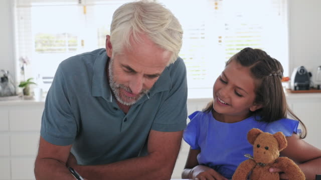 daughter with father in kitchen - western script stock-videos und b-roll-filmmaterial