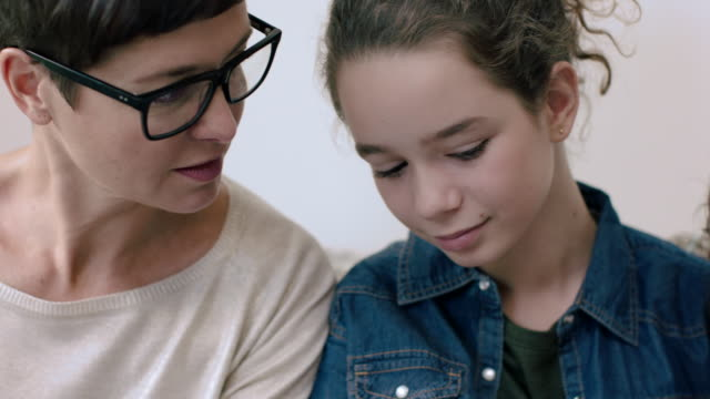 Daughters showing mom digital tablet