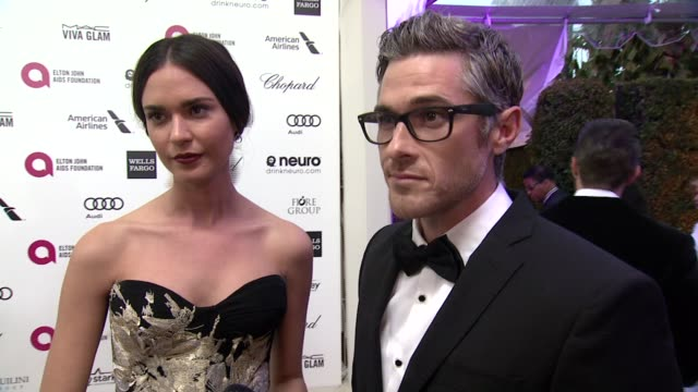 INTERVIEW Dave Annable and Odette Yustman on being at the event and on Elton John at the 23rd Annual Elton John AIDS Foundation Academy Awards...