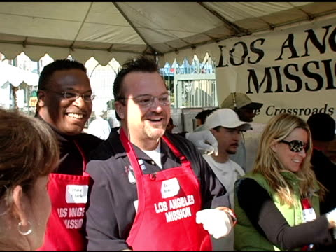 dave clark and tom arnold serving food at the 2004 thanksgiving meal for the homeless at the los angeles mission in los angeles, california on... - tom arnold stock videos & royalty-free footage