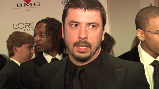 vídeos de stock, filmes e b-roll de dave grohl on clive davis' party making the grammy awards seem anticlimactic at the clive davis' pregrammy awards party arrivals at the beverly... - 2006