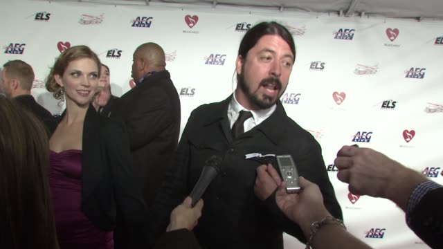 Dave Grohl on the meaning of his white ribbon the iconic status of Neil Diamond at the MusiCaresr 2009 Person Of The Year Tribute at Los Angeles CA