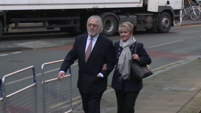 dave lee travis and marianne griffin arrive to hear the verdict at southwark crown court on 13th february 2014 - サウスワーク刑事法院点の映像素材/bロール