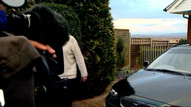 dave lee travis rearrested on suspicion of sexual offenses england bedfordshire leighton buzzard ext dave lee travis approaches press outside house... - レイトンバザード点の映像素材/bロール