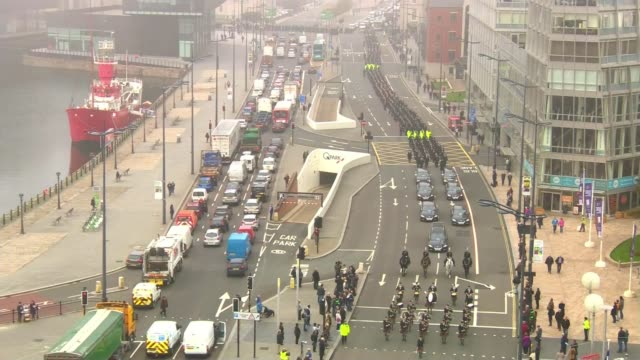 PC Dave Phillips funeral in Liverpool ENGLAND Merseyside Liverpool EXT **Bagpipe music heard SOT** High angle view of police procession along...