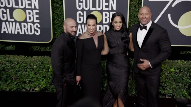 Dave Rienzi Dany Garcia Simone Garcia Johnson and Dwayne Johnson at the 75th Annual Golden Globe Awards at The Beverly Hilton Hotel on January 07...