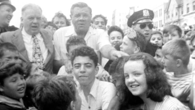 vídeos de stock, filmes e b-roll de dave soden hosts an annual day at the beach for 3000 orphans / baseball heroes babe ruth and dixie walker are surrounded by children and share hot... - 1946