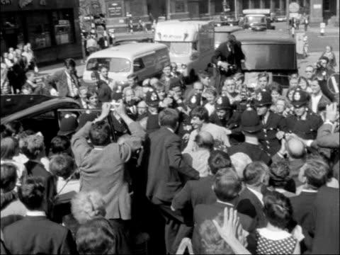 stockvideo's en b-roll-footage met david bailey marries; england: london: st pancras registry office: bride catherine deneuve along in mob l-r mick jagger in to bv l-r bride and groom... - itv evening bulletin