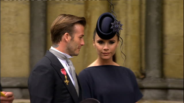 stockvideo's en b-roll-footage met david beckham and family to stay in us lib london westminster abbey ext david beckham and pregnant wife victoria beckham lining up with other guests... - westminster abbey
