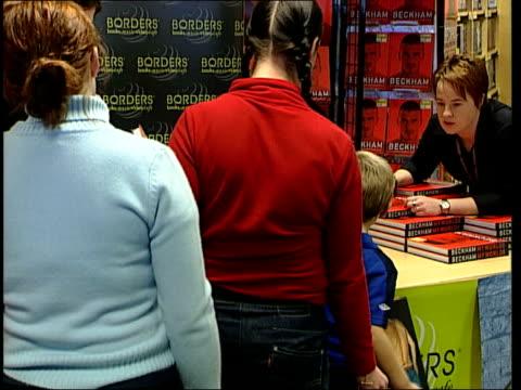 david beckham book signing; england: london: borders bookshop: int **beware flash photography** gvs david beckham pose for photocall with group of... - boys beware点の映像素材/bロール