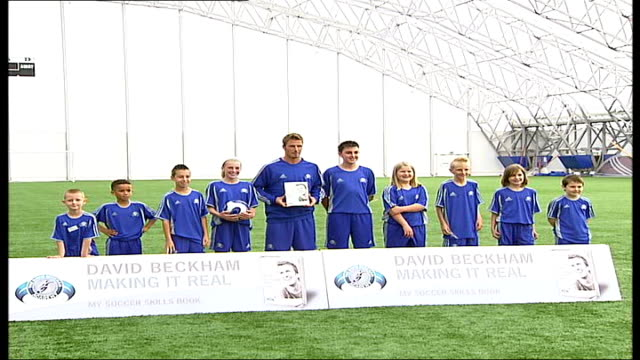 david beckham has no plans to quit international football; **beware flash photography** england: london: greenwich: david beckham football academy:... - boys beware点の映像素材/bロール