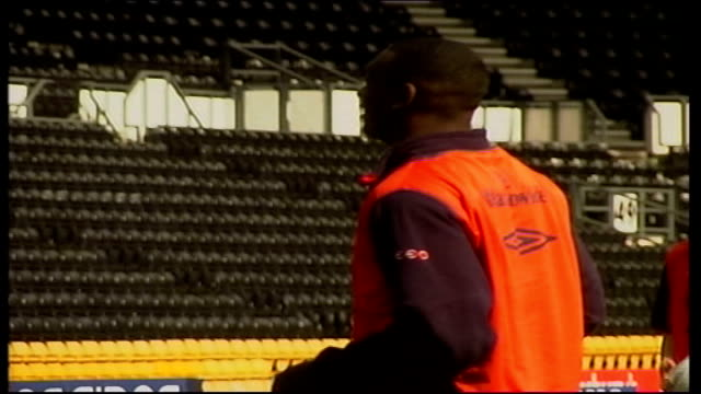 stockvideo's en b-roll-footage met trains with england itn england derby pride park ext england players lined up as listening to sven goraneriksson / goraneriksson / players listening... - hanenkam haardracht