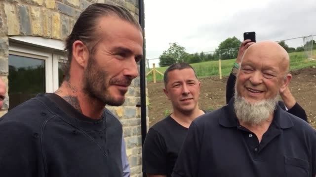 David Beckham opens a social housing development in Pilton Somerset with Michael Eavis the founder of the Glastonbury Festival