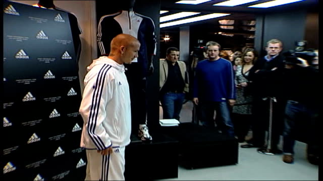 david beckham opens new adidas store; england: london: oxford street: adidas store: int press gathered as david beckham along and places his foot... - mineral stock videos & royalty-free footage