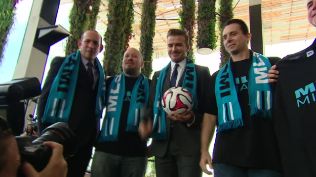 david beckham posing for photos at launch event for his new mls team in miami florida - major league soccer stock videos and b-roll footage