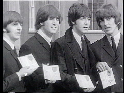 david beckham receives obe lib 1965 b/w shot the beatles posing with their medals john lennon at microphone tv presenter floella benjamin posing with... - floella benjamin stock videos & royalty-free footage