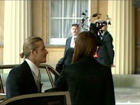 david beckham receives obe lunchtime news u'lay david beckham with wife victoria clean feed tape = d0625891 or d0625890 000653 000724 fx - order of the british empire stock videos and b-roll footage
