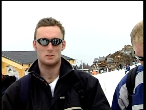 skiing holiday david beckham skiing holiday gv skiers on slopes outside ski school vox pops british holidaymakers sot cable car along up ski slope... - ski holiday stock videos & royalty-free footage