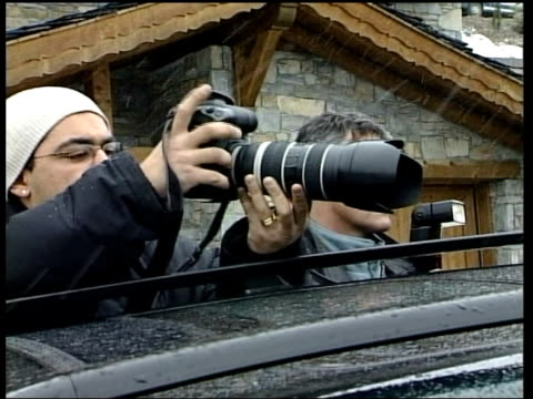 skiing holiday David Beckham skiing holiday ITN FRANCE Courchevel Door of chalet where Beckham family are holidaying PULL OUT MS Media outside CMS...
