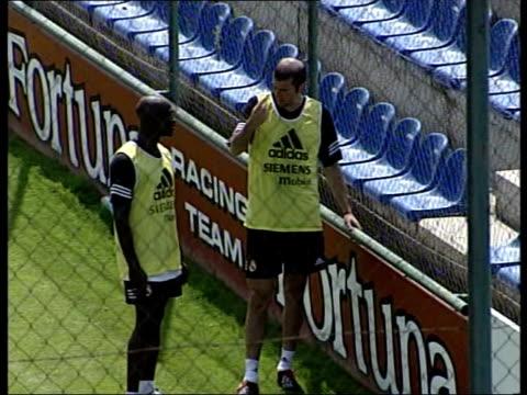 David Beckham transfer to Real Madrid ITN Madrid Real Madrid players training on pitch Ronaldo playing in training match Zinedine Zidane tackled...