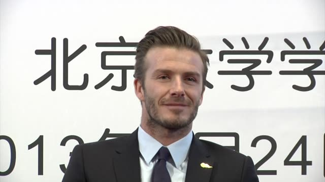 david beckham visits peking university on march 24, 2013 in beijing, china. shows tattoo on torso - celebrities stock videos & royalty-free footage
