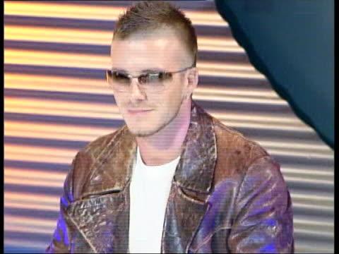 wealth lib david beckham taking part in photocall to promote police sunglasses - 2003 bildbanksvideor och videomaterial från bakom kulisserna