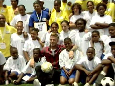 David Beckham with new haircut photo with young footballers in Cape Town South Africa