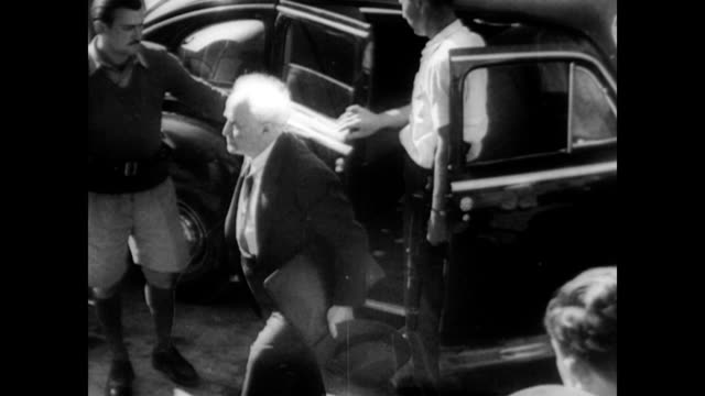 stockvideo's en b-roll-footage met / david bengurion salutes after stepping out of car in tel aviv / israeli soldiers guard the entrance to the government building and salute bengurion... - 1948