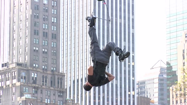 david blaine hangs upside down in central park - hanging stock videos & royalty-free footage