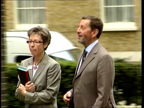 david blunkett controversy over jobs taken out of office; tx 9.5.2005 downing street: blunkett along with unidentified woman - david blunkett stock videos & royalty-free footage
