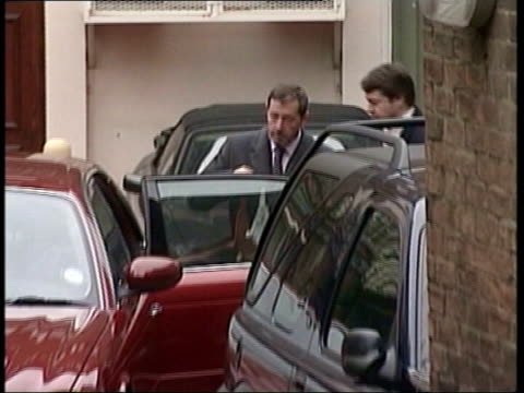 david blunkett leaving his house and getting into jaguar as people walk in f/g zoom in - david blunkett stock videos & royalty-free footage