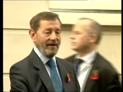 david blunkett resigns as work & pensions secretary: day's events; ext david blunkett mp out of doorway, accompanied by aides, and into waiting car... - david blunkett stock videos & royalty-free footage