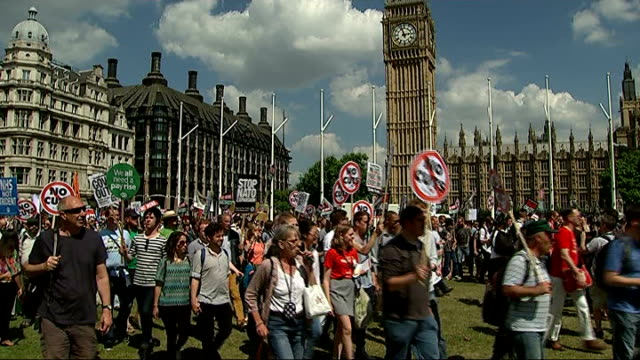 david blunkett to stand down at next election; england: london: westminster: ext various gvs anti-austerity protesters marching through parliament... - david blunkett stock videos & royalty-free footage