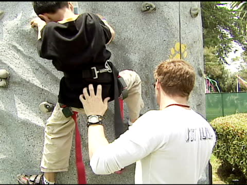 David Boreanaz on working the rock wall and how talented the kids are on how good it feels to be out raising money for Pediatric AIDS research at the...
