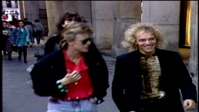 david bowie and peter frampton walking down madrid street into car - 1987 stock videos & royalty-free footage