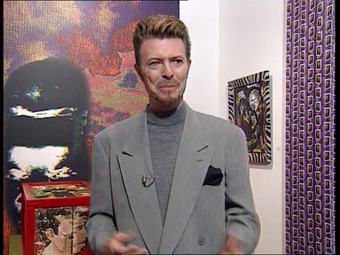 stockvideo's en b-roll-footage met art works exhibited itn england london painting by david bowie on wall at exhibition cms paintings with sculptures on display in f/g cms painting pan... - david bowie
