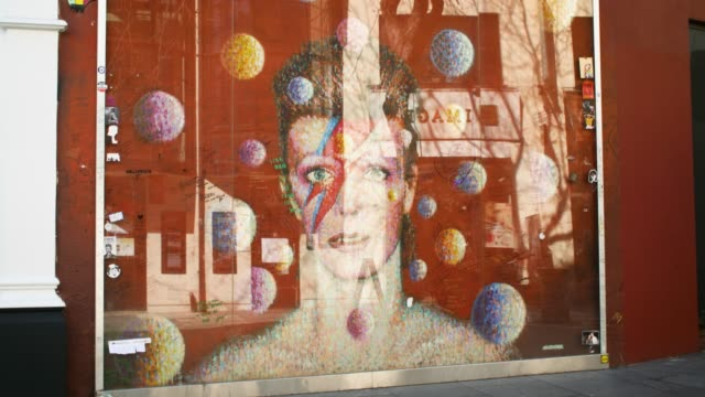 WS of David Bowie mural, Brixton