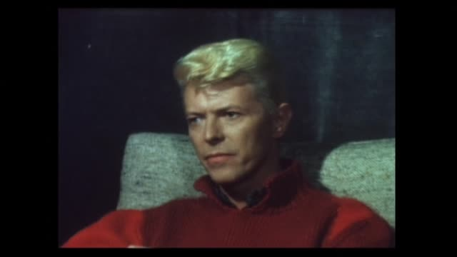 stockvideo's en b-roll-footage met david bowie smoking cigarette in 1983 during interview about working with nile rogers and stevie ray vaughan on recent let's dance album and his own... - david bowie