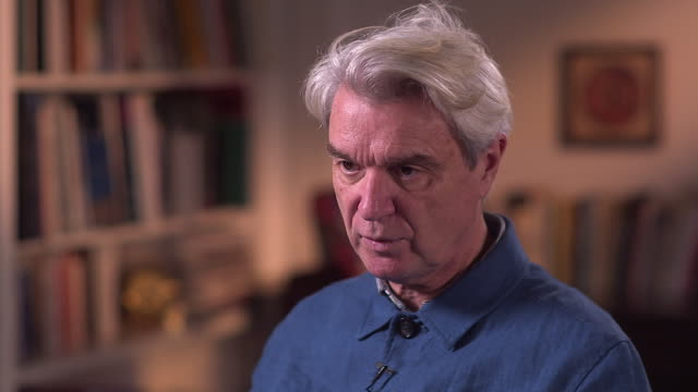 david byrne talks about his new single 'everybody's coming to my house' - brian eno stock videos & royalty-free footage