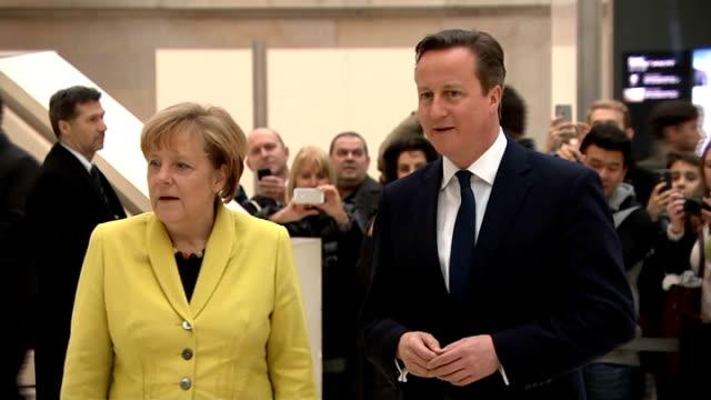 David Cameron and Angela Merkel visit British Museum ENGLAND London British Museum INT Angela Merkel and David Cameron MP into exhibition hall and...