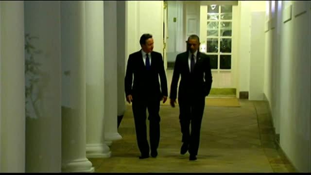 David Cameron and Barack Obama pledge to combat domestic extremism USA Washington White House PHOTOGRAPHY** Barack Obama and David Cameron walking...