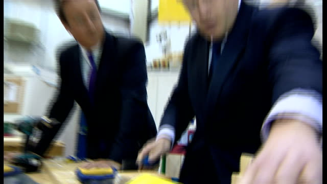 david cameron and boris johnson visit harrow skills academy johnson and cameron chatting to apprentice johnson uses chisel to cut wood sot / cameron... - chisel stock videos and b-roll footage