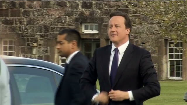 david cameron and danny alexander visit black watch regiment scotland fort george ext car driving along / various of soldiers waiting / scottish... - motorcade stock videos & royalty-free footage