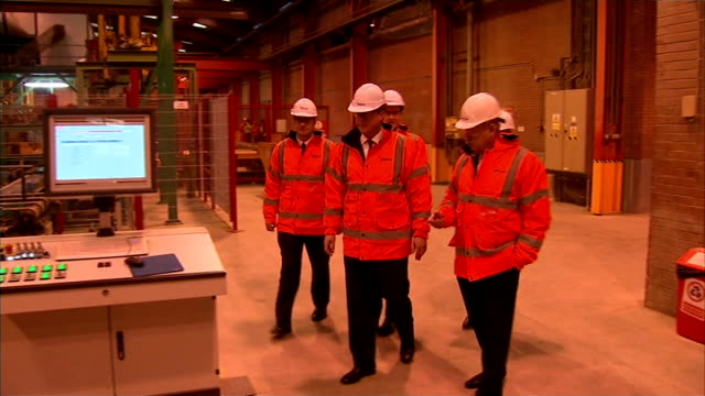 vídeos de stock, filmes e b-roll de david cameron and george osborne visit brick factory in accrington england lancashire accrington ext george osborne mp interview sot on launching... - lancashire