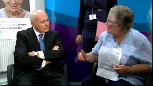 david cameron and iain duncan smith at age uk england london camden int iain duncan smith mp chatting to pensioners / pensioners chatting in groups /... - cufflink stock videos & royalty-free footage