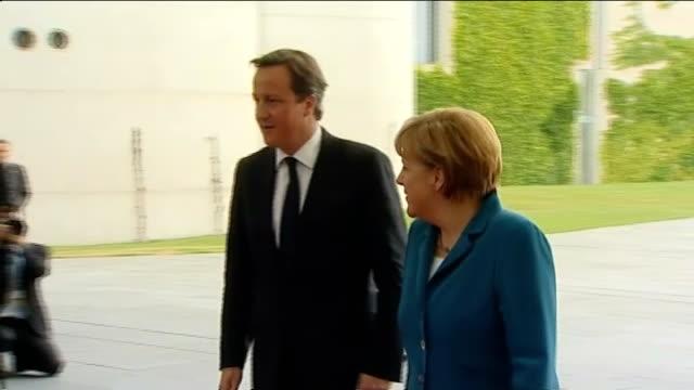 David Cameron and Jens Stoltenberg meet Angela Merkel in Berlin GERMANY Berlin EXT David Cameron MP out of car and greeted by Angela Merkel / Merkel...