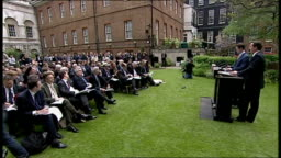 David Cameron and Nick Clegg joint press conference on first day of     Stock Footage Video
